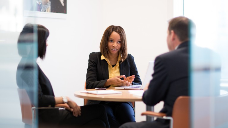 Female in meeting with two colleagues