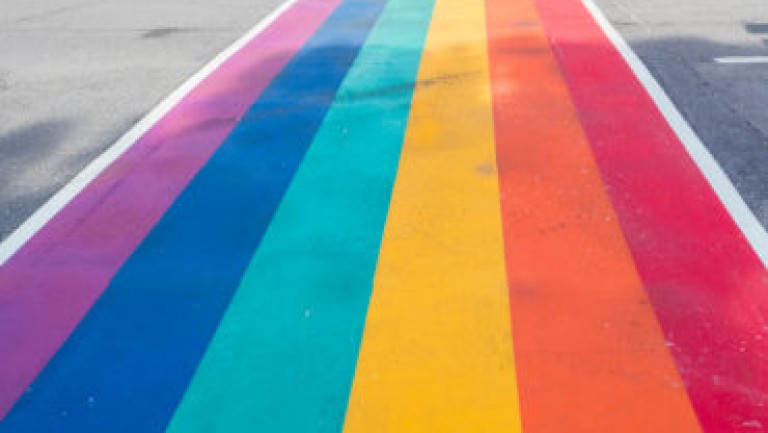 LGBT pride flag painted on roadway