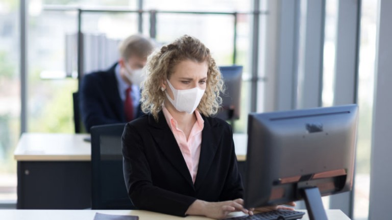 Women in office wearing mask