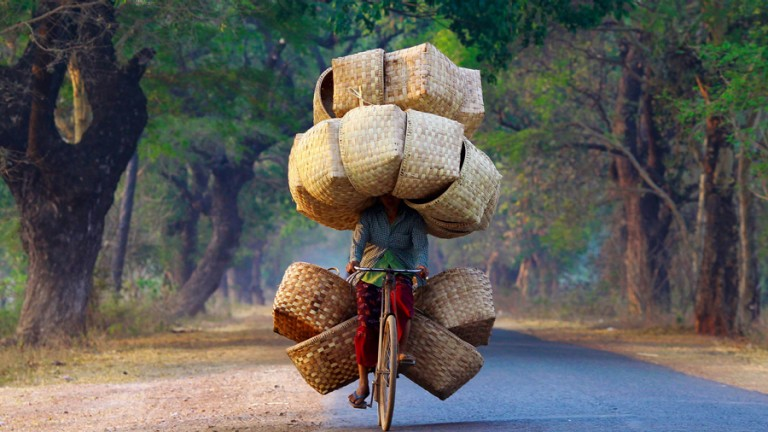 Woman on bicycle with baskets
