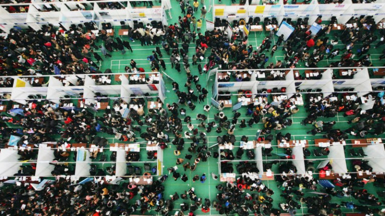 Job seekers attend a job fair at Tianjin University November 22, 2013. According to local media, more than 6,000 people rushed to the job fair on Friday for openings from 300 companies against the backdrop that a decrease is expected in available positions for fresh graduates in the China job market in 2014.