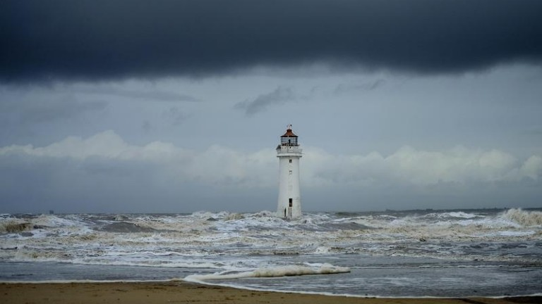 Storm clouds gather above Perch Rock lighthouse