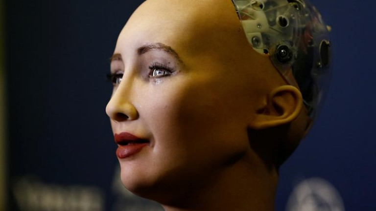"Sophia, a robot integrating the latest technologies and artificial intelligence developed by Hanson Robotics is pictured during a presentation at the ""AI for Good"" Global Summit"
