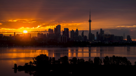 The sun rises over the skyline in Toronto, August 4, 2015
