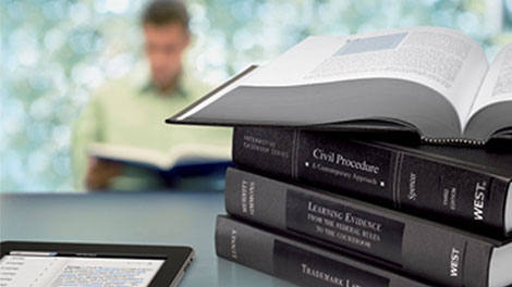 Tablet and stack of law reference books