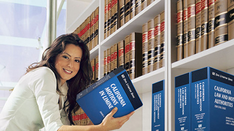 Woman holding law book in law library