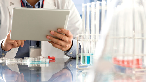 Scientist uses tablet for analysis in lab