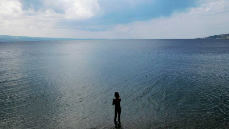 A boy stands in the water of the Adriatic sea near the Croatian city of Omis September 13, 2008.