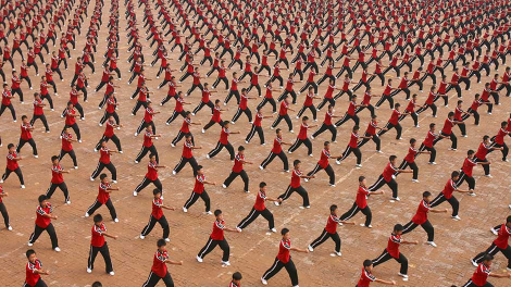 Shaolin students perform martial arts at Tagou Wushu School in Dengfeng, Henan province August 23, 2009.