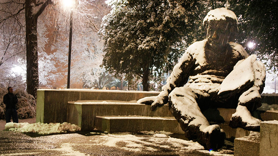 Snow falls on the Albert Einstein Memorial Statue at the National Academy of Sciences in Washington D.C during the early morning hours of February 3, 2010.
