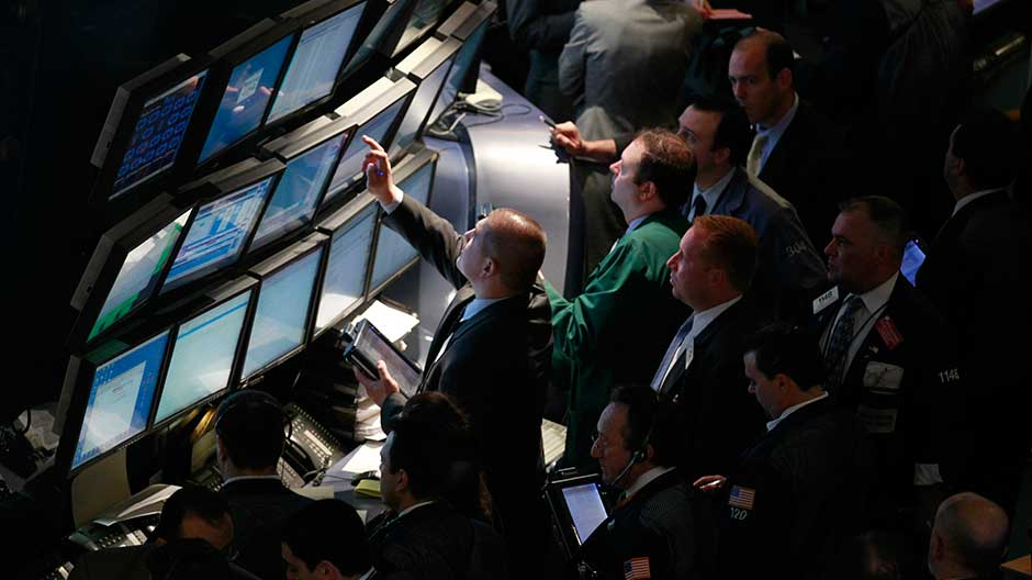 Floor traders gather at the NYSE's Operations Control Center on the floor of the New York Stock Exchange, May 25, 2010.