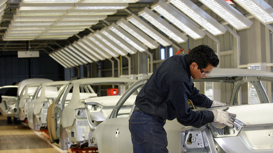 An employee works on the assembly line at the Volkswagen (VW) automobile manufacturing factory in Puebla August 12, 2010.