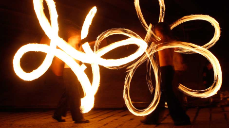 Artists perform during a fire show in Minsk August 30, 2010.