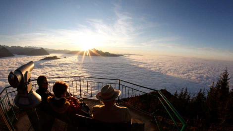 People enjoy the look at the clouds during sunny autumn weather from the Chaenzeli panorama view point at Mount Rigi , at 1,797 m (5,896 ft) above sea level, near Lake Lucerne November 13, 2011.