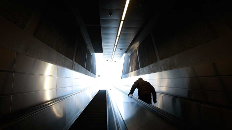 A commuter comes out of a closed metro station during a 24-hour metro strike in Athens January 17, 2012.