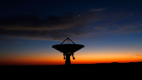Dawn breaks over a radio telescope dish of the KAT-7 Array pointing skyward at the proposed South African site for the Square Kilometre Array (SKA) telescope near Carnavon in the country's remote Northern Cape province in this picture taken May 18, 2012.