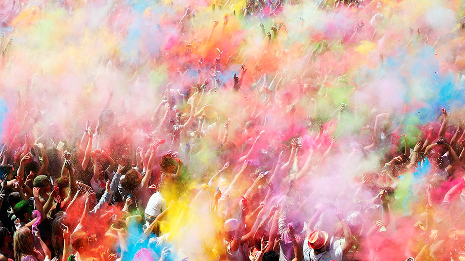 People throw coloured powder during the Holi festival in Barcelona April 6, 2014.