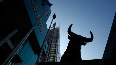 A sculpture of a bull is seen outside the Shenzhen Stock Exchange at the southern Chinese city of Shenzhen in Guangdong province November 25, 2008.