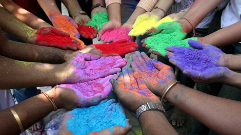 Students holding powder paint of various colours pose as they celebrate Holi, the Indian festival of colours, in the western Indian city of Ahmedabad March 10, 2009.