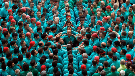 The group 'Castellers de Vilafranca' begin to form a human tower called 'Castell' during a biannual competition in Tarragona city (north-eastern of Spain) October 3, 2010.