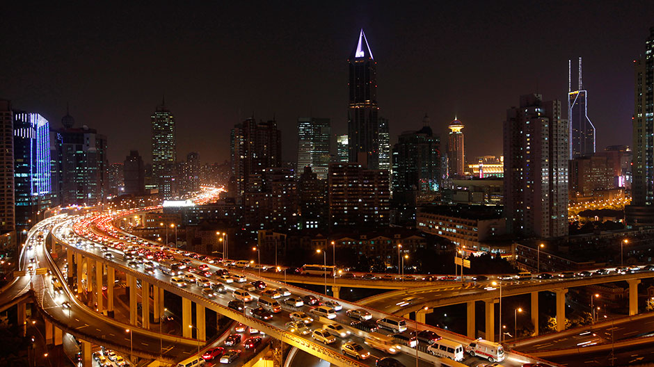 Vehicles drive on flyovers during the evening rush hour in central Shanghai December 29, 2010.
